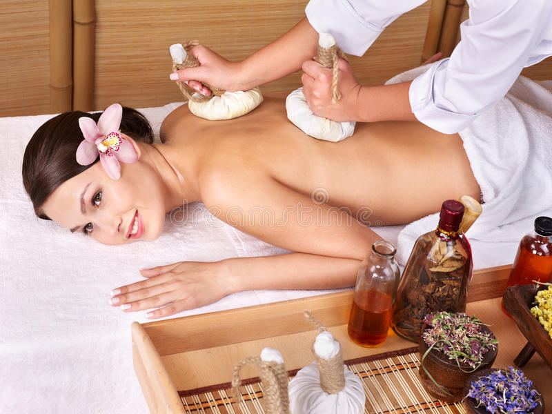 Young woman on massage table in beauty spa. royalty free stock photography