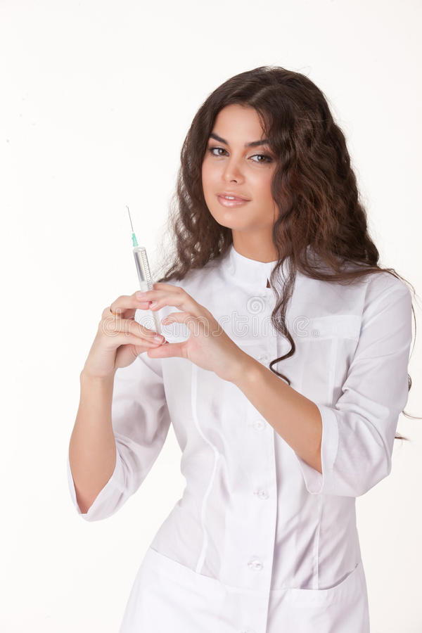 Young Woman In The Medical Uniform. On background stock images