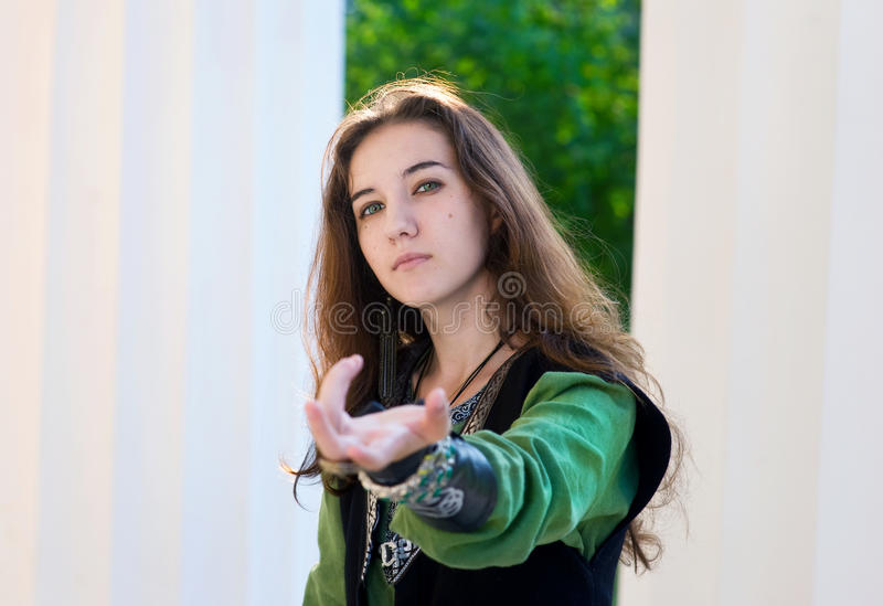 Young Woman In Medieval Suit Give A Hand Stock Photo