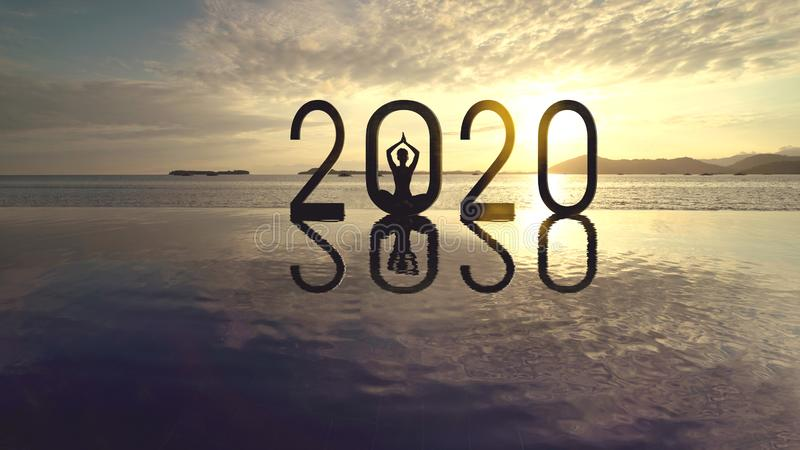 Young woman meditating with number 2020 stock images