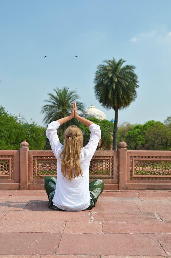 Young woman meditating in the yard of Humayun's Tomb. Delhi stock photos