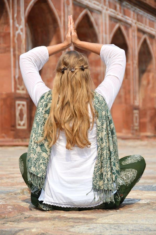 Young woman meditating in the yard of Humayun's Tomb. Delhi royalty free stock photos