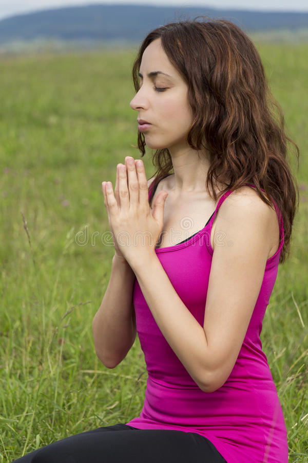 Young woman in meditation outdoors royalty free stock images