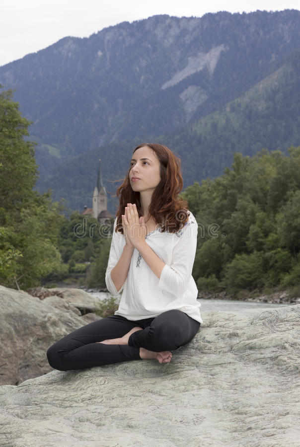 Young woman in meditation outdoors stock photography