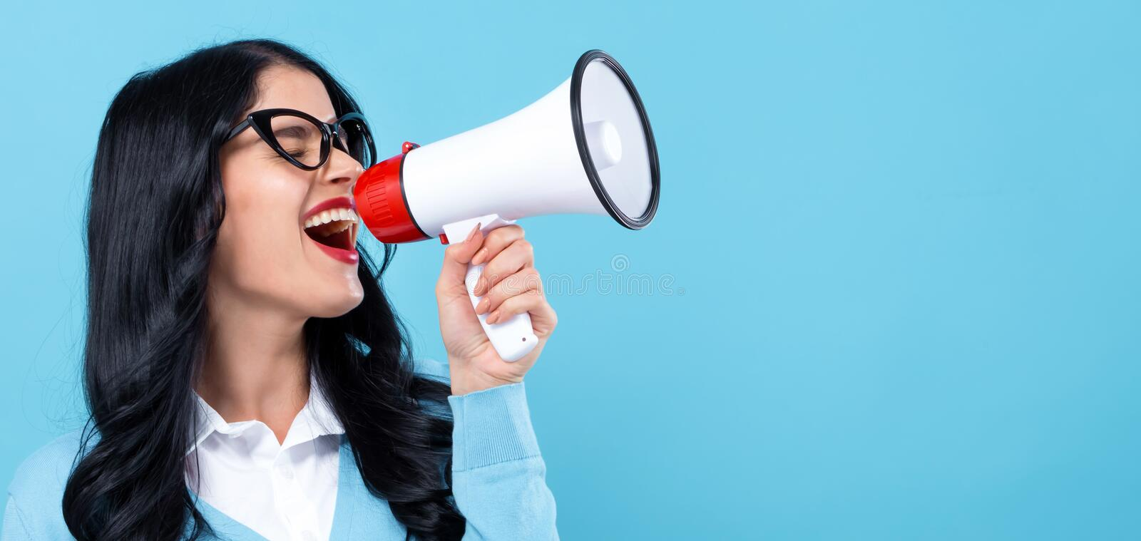 Young woman with a megaphone stock photography