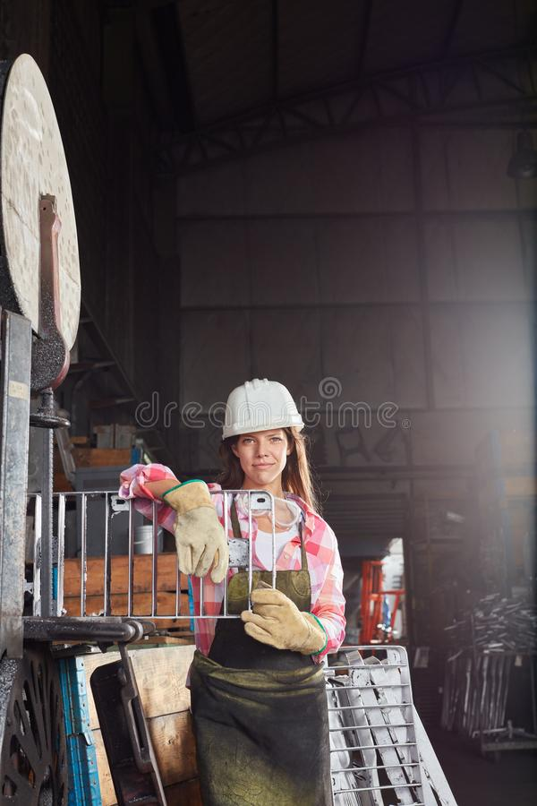 Young woman in metal construction apprenticeship stock image