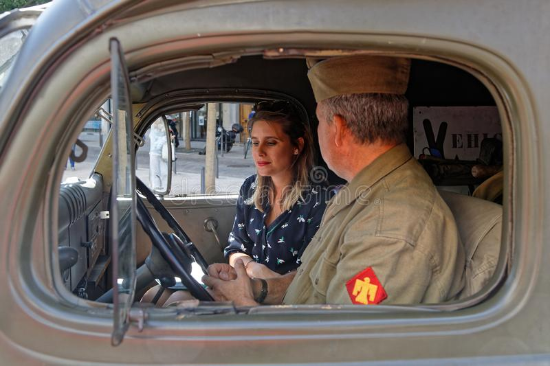 Young woman and a military driver inside a truck stock photos
