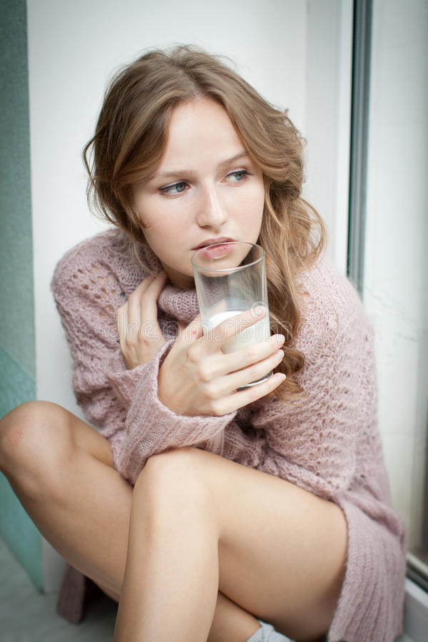 Young woman and milk. stock image