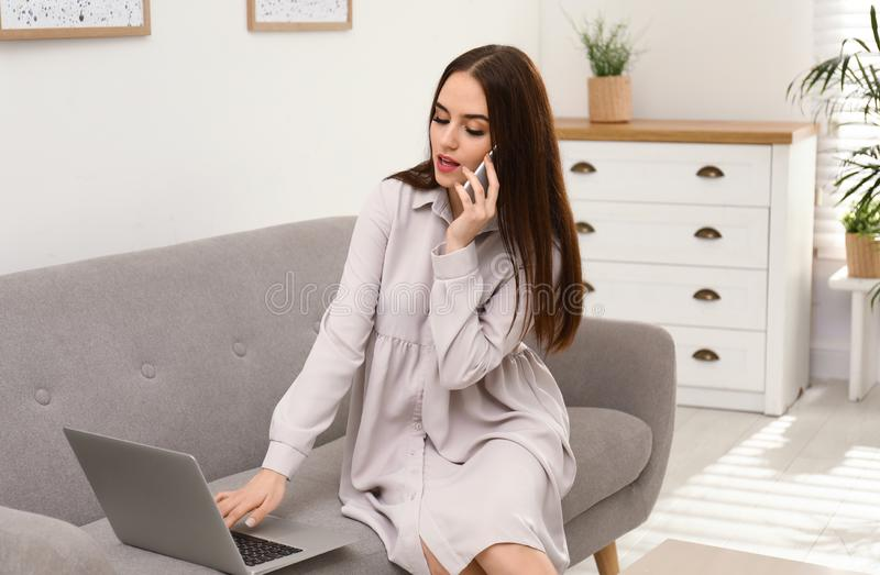 Young woman with modern laptop and mobile phone royalty free stock photo
