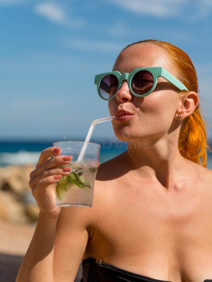 Young woman with mojito stock image
