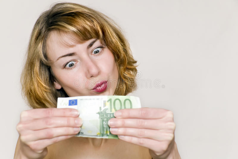 Young woman with money stock photography