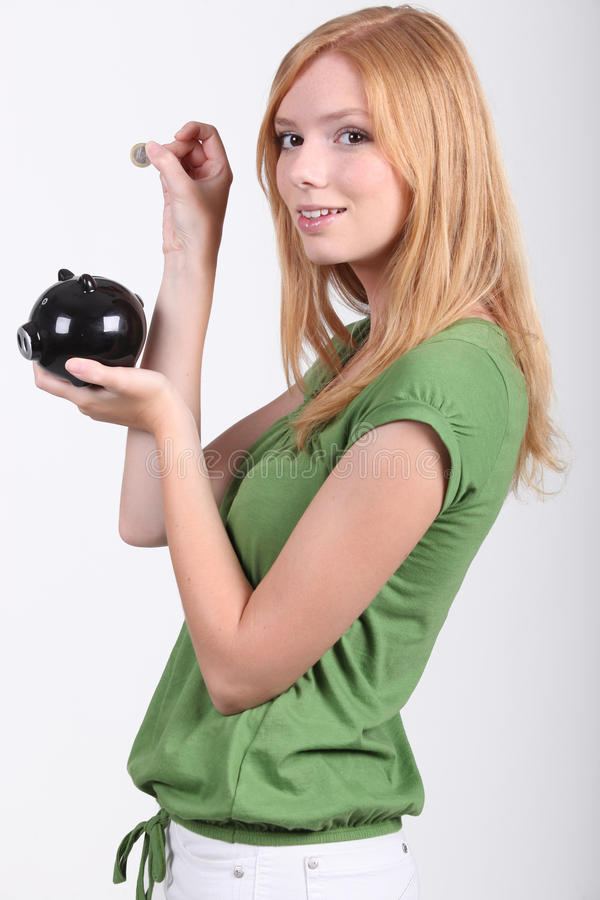 Download Young woman with money box stock photo. Image of funny - 26936892