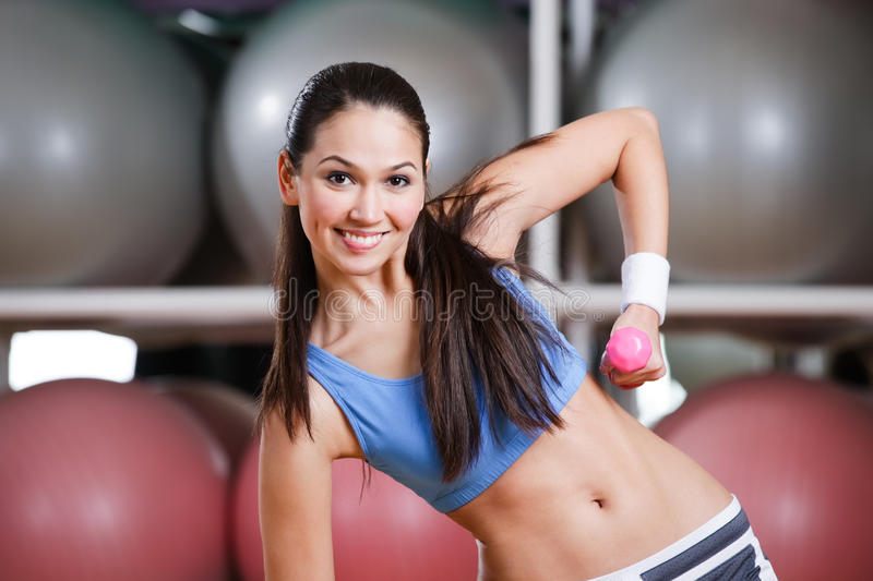 Download Young Woman In Motion With Dumbbells Stock Image - Image: 27490347