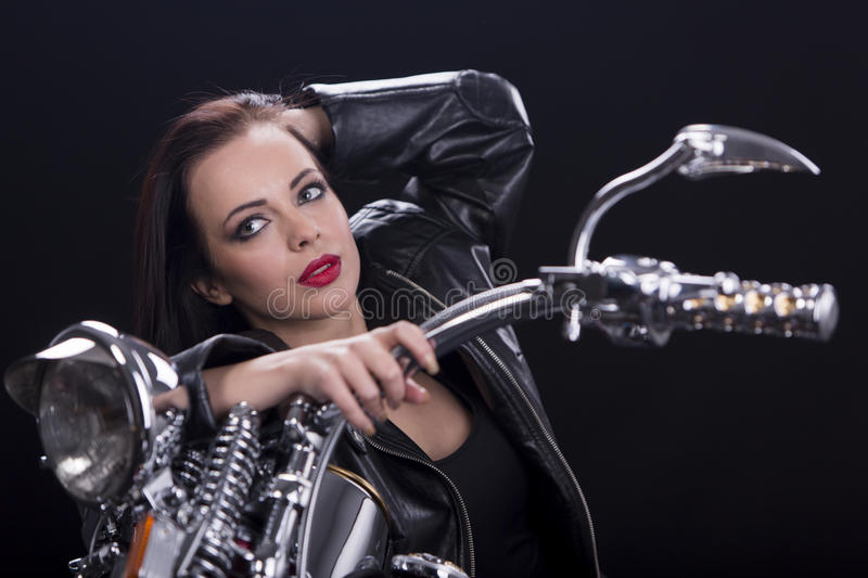 Young woman on motorcycle stock images