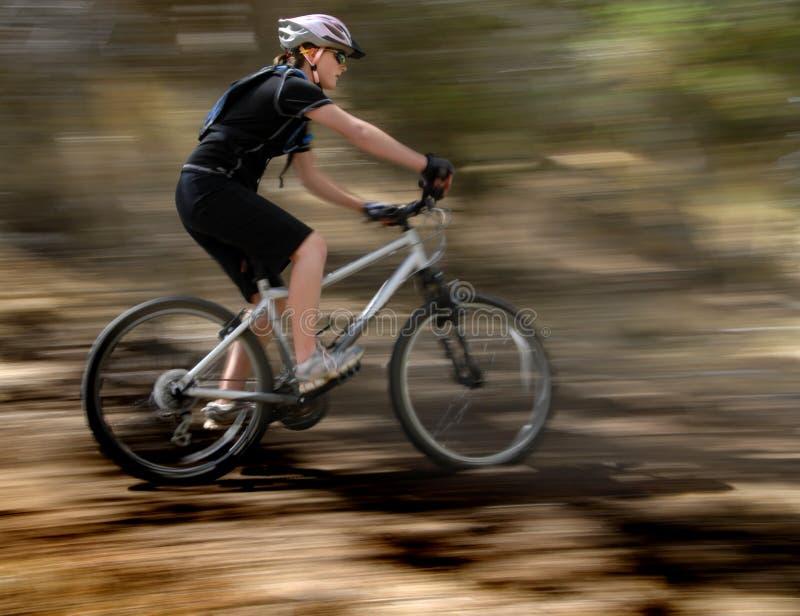 Young Woman Mountain Biking stock photos