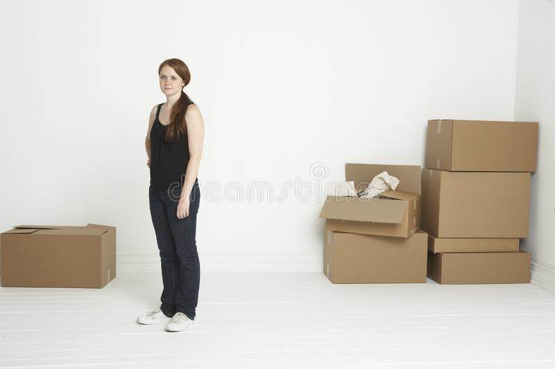 Young woman with moving boxes royalty free stock images