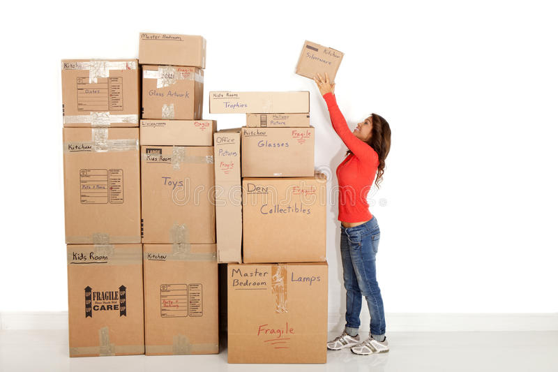 Young woman moving boxes stock photos
