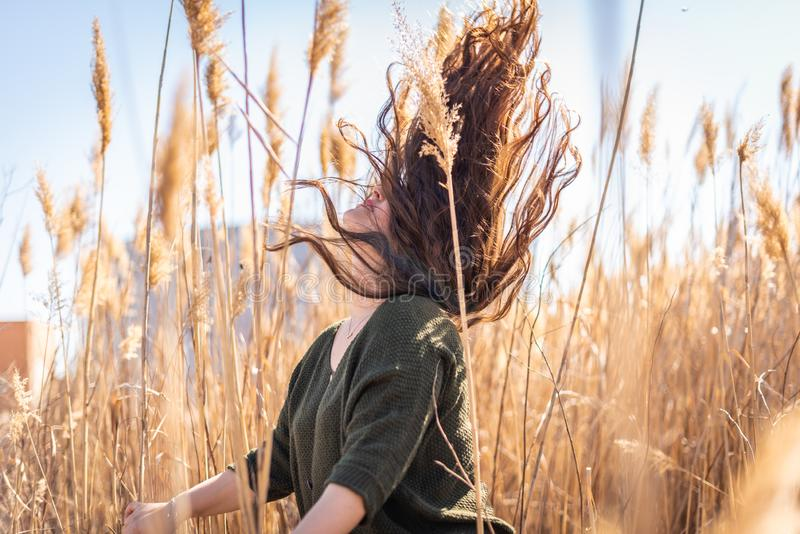 Young Woman Moving her Hair Outdoors stock image