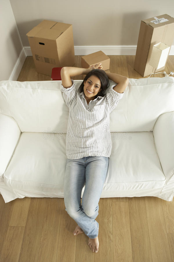 Download Young Woman Moving Into New Home Stock Image - Image: 12406999