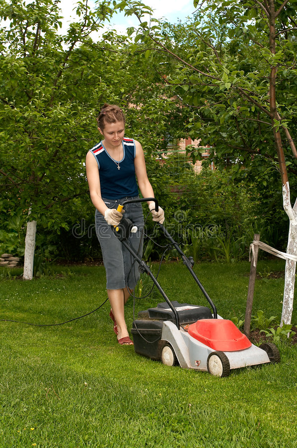 Download Young woman mow grass stock image. Image of woman, tree - 1431185