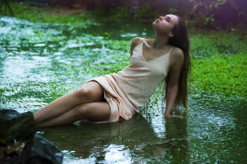 Young woman in muddy field stock photo