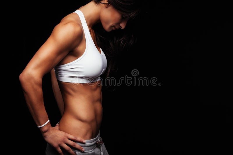 Young woman with muscular body royalty free stock photos