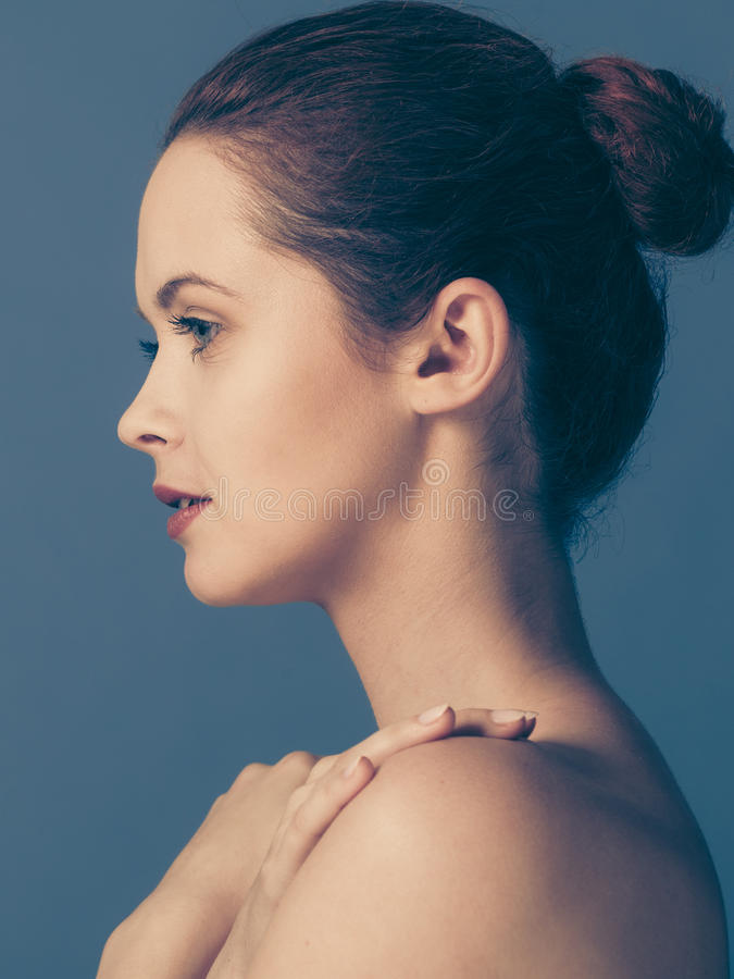 Young Woman With Naked Shoulders, On Blue Stock Photo