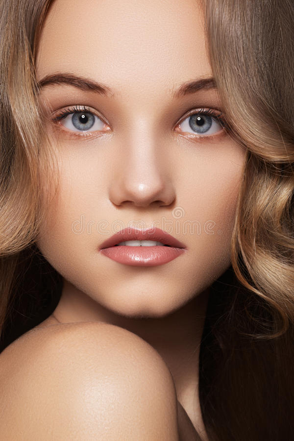 Young woman with natural make-up & long shiny hair. Healthcare, spa, wellness. Beauty and skin care. Close-up portrait of beautiful woman with natural make-up royalty free stock photo