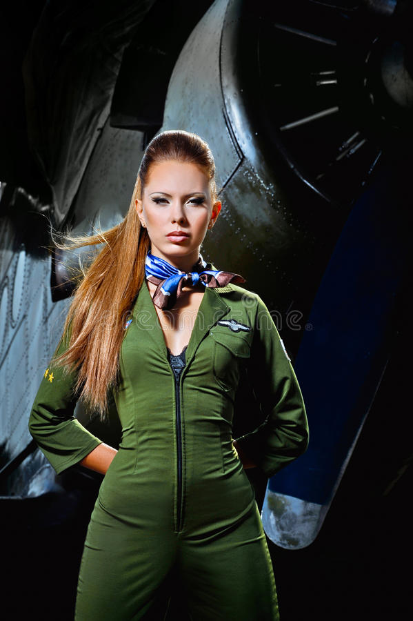 Young woman near the aircraft stock photography