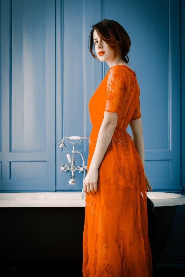 Young woman near bath stock photography