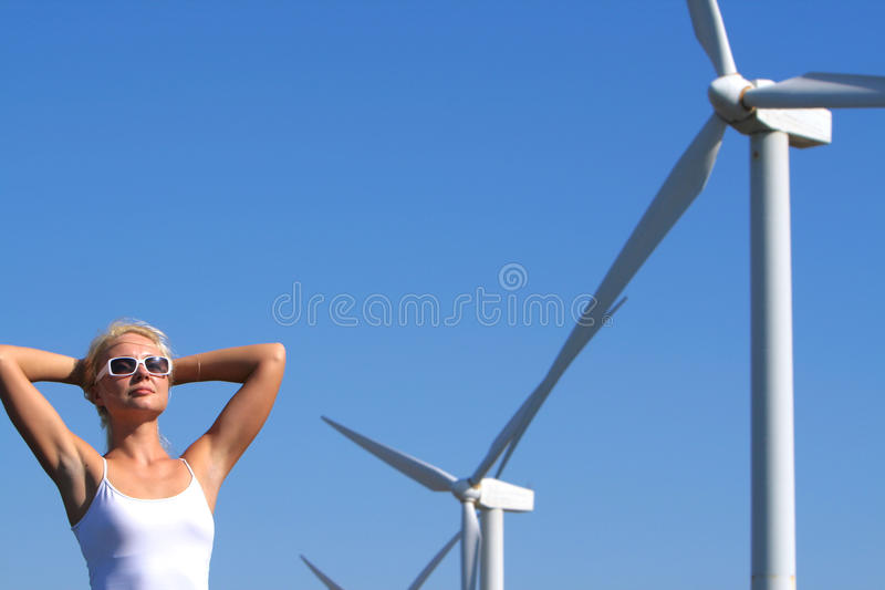 Young woman near eolic generator royalty free stock photography