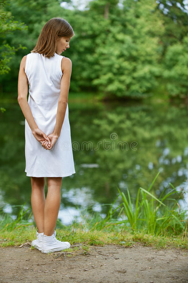 Download Young woman near lake stock photo. Image of face, back - 24778918