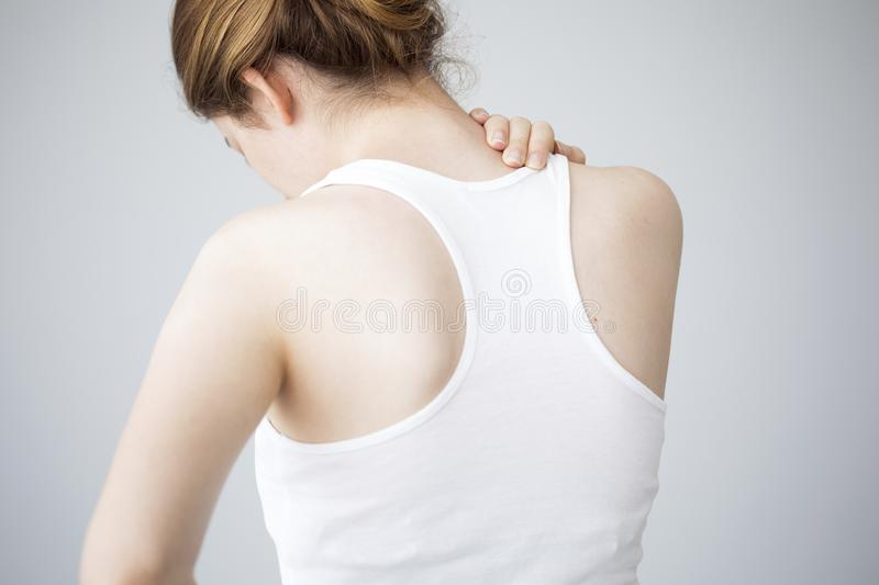Young woman with neck pain stock photography