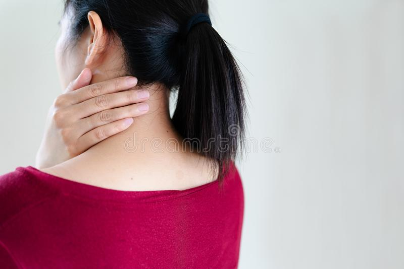 Young women neck and shoulder pain injury, healthcare and medical concept. Young woman neck and shoulder pain injury, healthcare and medical concept stock photos