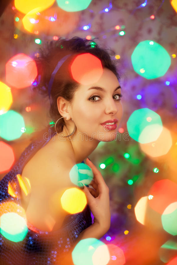 Young woman in night clubs lights. Luxury nightclub lifestyle. F. Ashion girl in night party, on luxury background royalty free stock photography