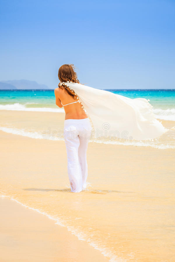 Download Young woman on ocean beach stock image. Image of sunshine - 38903285