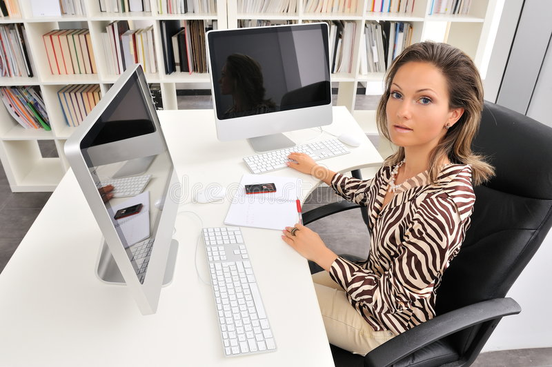Download Young woman at the office stock photo. Image of leader - 7232010