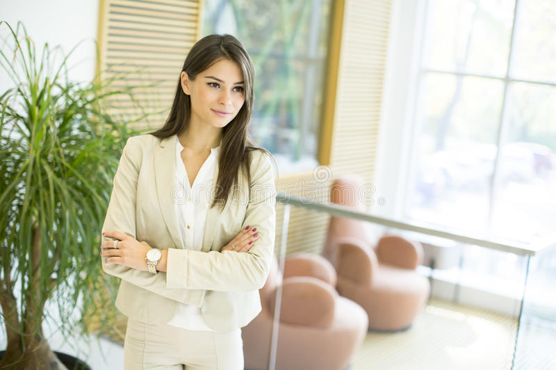 Young woman in the office. Pretty young woman in the office stock images