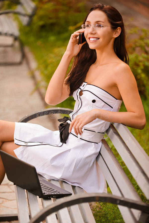 Free Young Woman On Bench Talks By Phone Royalty Free Stock Image - 19862446