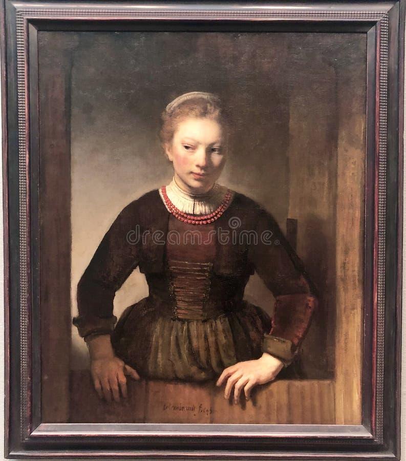Young Woman At An Open Half Door stock image