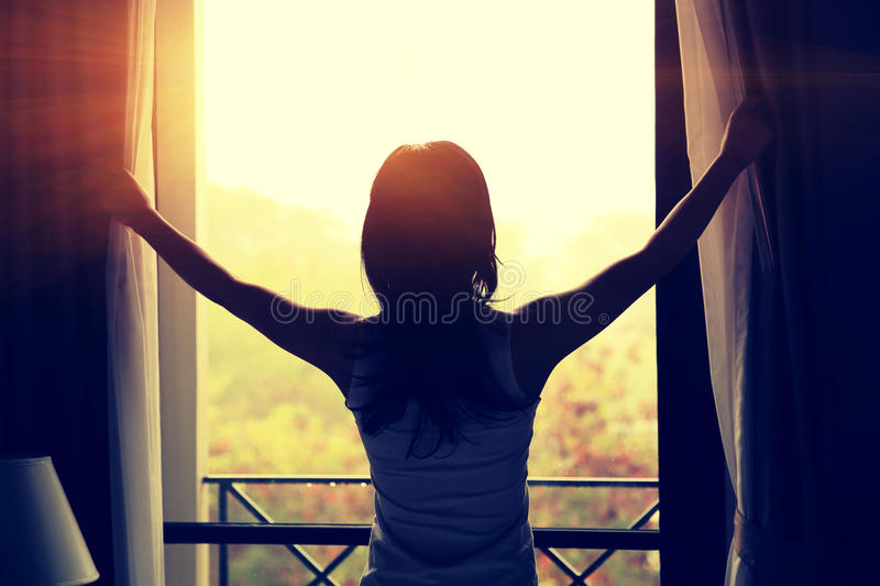 Young woman open window royalty free stock photo