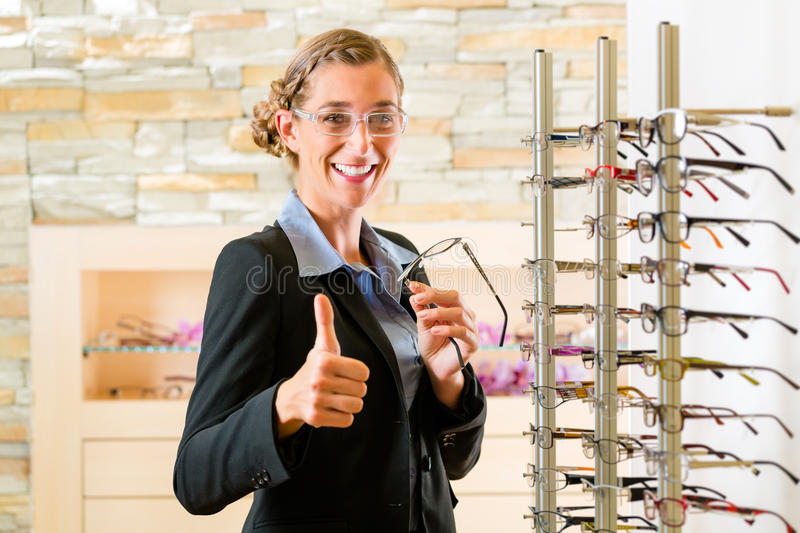 Download Young Woman At Optician With Glasses Stock Photo - Image: 30387090