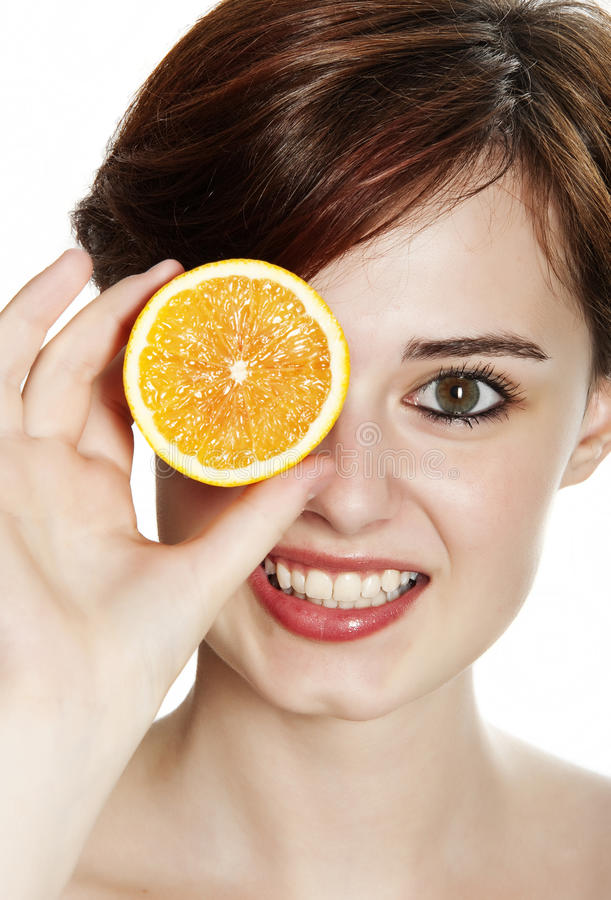 Download Young woman with an orange stock image. Image of casual - 26170855