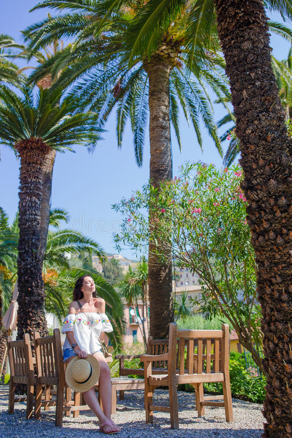 Young woman at outdoor cafe on summer vacation in beautiful resort in Cinque Terre, Italy stock photography