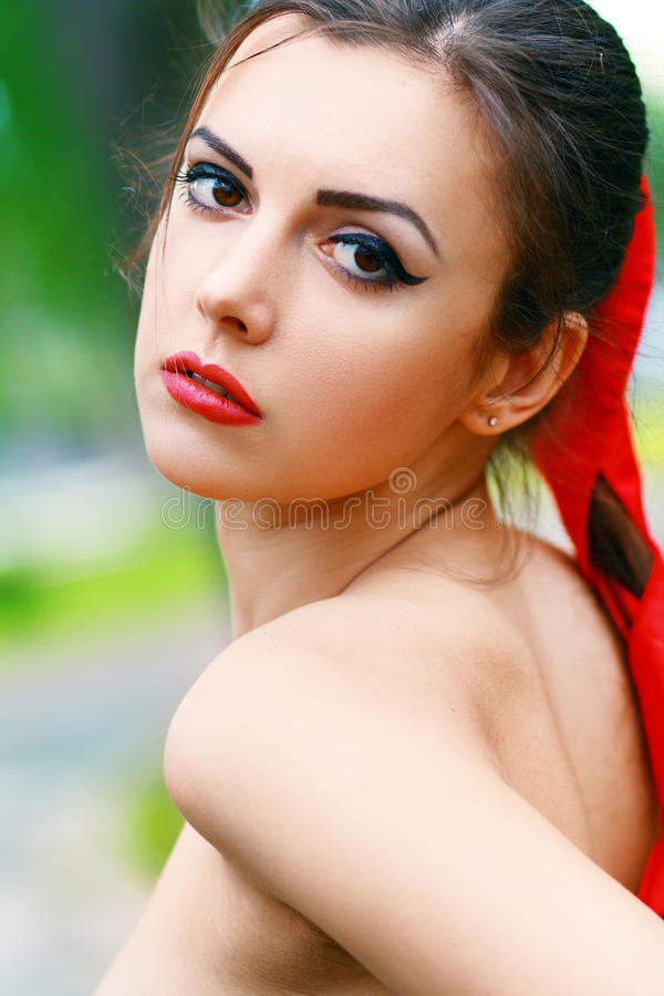 Young woman outdoor. Outside close-up portrait of beautiful young happy woman with fresh and clean skin royalty free stock photography