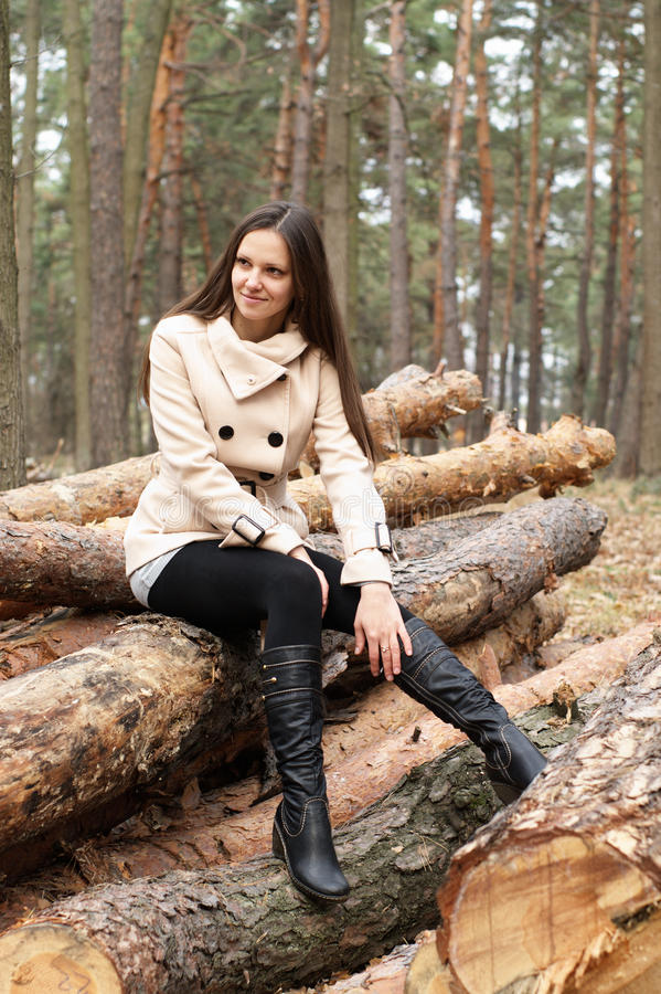 Young woman outdoors in forest royalty free stock photo