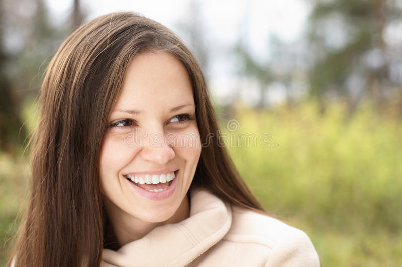 Young woman outdoors on green royalty free stock images