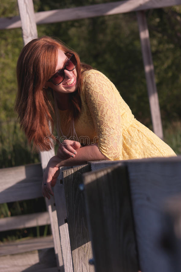Young Woman outside laughing stock image