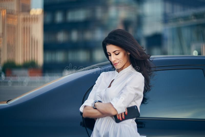 Young woman over modern office facade stock photography