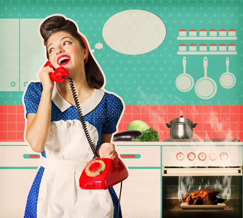 Young woman overlooked roast chicken in an oven. Retro young woman overlooked roast chicken in an oven.Housewife talking on phone in her kitchen interior. Poster stock images